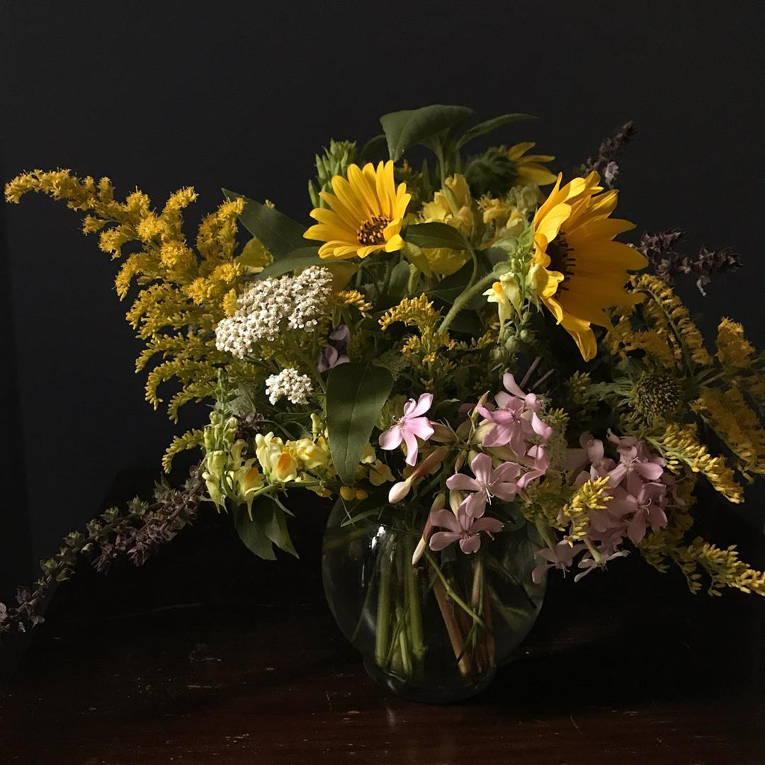 arrangement of purple and yellow wildflowers